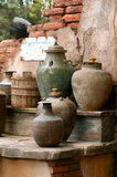 Old desert water well and vessels of water Stock Image