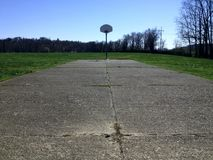 Old deserted basketball court with grass Royalty Free Stock Photography