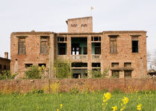 Old deserted building. An old deserted building in a village Stock Photo