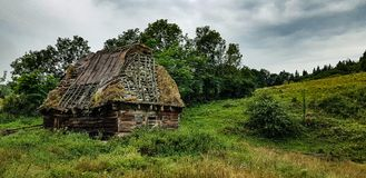 Ancestry. Old deserted catle stable in Apuseni mountains stock image