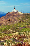 Old deserted lighthouse on greek island mykonos Stock Photos