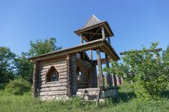 Old deserted log house. Chapel stock photos