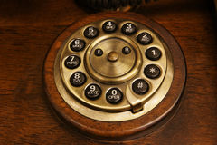The old desk's phone dial disc Stock Image