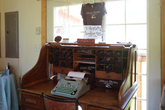 Old desk with typewriter and tourist shirts at vineyard tasting room Stock Images