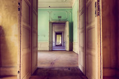 Old desolate mansion opening his rooms Stock Images