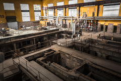 Old desolate metallurgical firm inside space Stock Photos