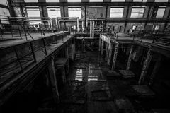 Old desolate metallurgical firm inside space Stock Images