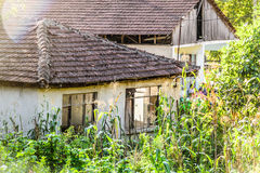 Old Village Houses. Old and desolated village houses front with some wonderful details and textures that reflect the history of the establishment. Photo taken at royalty free stock photos