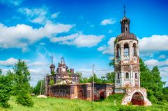 The old destroyed abandoned church. Blue sky. Old brick ruined abandoned church Stock Images