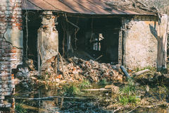 Old destroyed and abandoned house is flooded with water. royalty free stock image