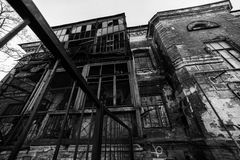 Old destroyed building. Grunge black and white background Stock Photos
