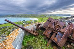 Free Old Destroyed Cannon In Hamningberg Coastal Fort, German Military Vestige Of 2d World War Pastime. The Abandoned Fishers' Royalty Free Stock Photography - 165471897