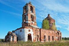 Old destroyed church. Old orthodox dilapidated church from a red brick against a field and the dark blue sky stock images