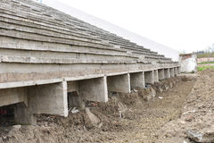 Old destroyed grandstands at stadium under construction Stock Photo