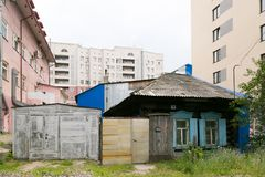Old destroyed house among the new houses royalty free stock image