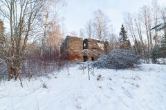 The old destroyed house in winter wood Stock Photos