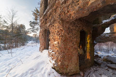 The old destroyed house in winter wood Royalty Free Stock Photography