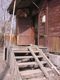 Old destroyed the old wooden porch of an abandoned house royalty free stock photo
