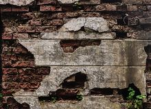 Old destroyed red brick wall Stock Images