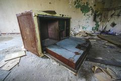 A old destroyed safe in a abandoned old house royalty free stock photo
