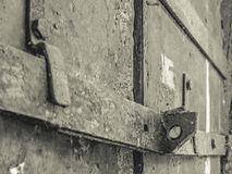 Old destroyed steel door monochrome stock images