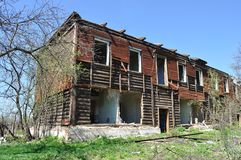 Old destroyed two-storeyed wooden house Royalty Free Stock Image