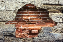 Destroyed wall with a brick Royalty Free Stock Photo