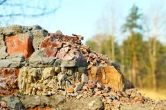 Old destroyed wall forest on background Royalty Free Stock Image