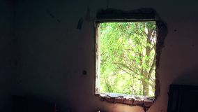 Old destroyed window. This is old abandoned house in village Ostrelj near city of Bor stock video footage