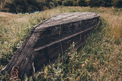 Old destroyed wooden boat on the ground.  Stock Images