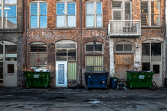 Old deteriorating building side. Building facade that looks dirty and polluted stock photos