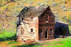 Old Deteriorating Frontier Home. An old abandoned desolate frontier homestead home sits in eastern Oregon Royalty Free Stock Photos