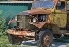 Old devastated truck. Front part of an old-fashioned rotting truck in the yard stock images