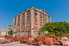 Old devastated warehouse. With roof tiles in front Stock Images