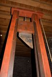 Old device to decapitate heads of condemned people. Mostly used in france, This one is one in a museum in ghent, guillotine.  The knife is original Stock Images