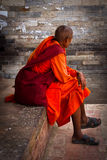Old devotee of Kathmandu, Nepal sits quietly Royalty Free Stock Images