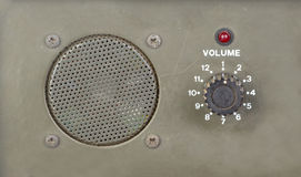 Old dial volume switch with speaker and red light indicator Royalty Free Stock Photography