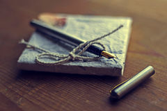 Old diary memories with fountain pen on a wooden table Stock Photo