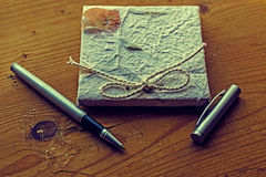 Old diary memories with pen on a wooden table 1 Royalty Free Stock Image
