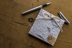 Old diary memories with pen on a wooden table 2 Royalty Free Stock Photography