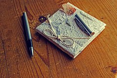 Old diary memories with pen on a wooden table Stock Images