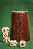 Old Dice Cup with Dices Stock Images