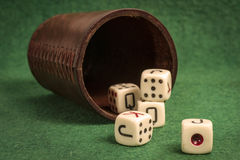 Old Dice Cup with Dices Royalty Free Stock Image