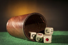 Old Dice Cup with Dices Royalty Free Stock Images