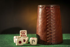Old Dice Cup with Dices Royalty Free Stock Photography