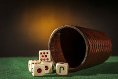 Old Dice Cup with Dices Stock Photo