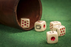 Old Dice Cup with Dices Royalty Free Stock Photo