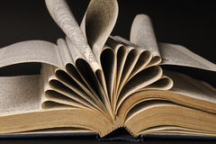 old dictionary. Closeup with pages of dictionary  on black background Royalty Free Stock Images