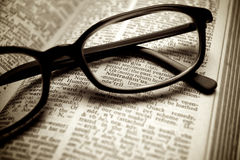Old dictionary and black glasses Royalty Free Stock Photography