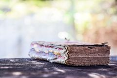 The Old Dictionary on Black Wood, Bokeh Nature Background - Dictionary : Important Knowledge Sources for Everybody royalty free stock image